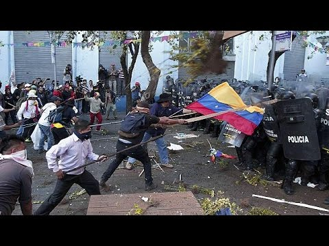 Ecuadorian protestors clashing with police with riot shields